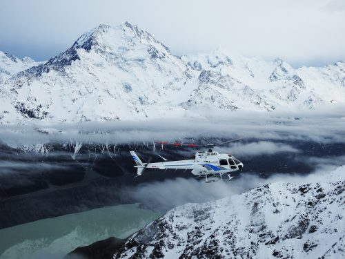 Heliworks Mount Cook, Helicopter flying in Aoraki National Park.